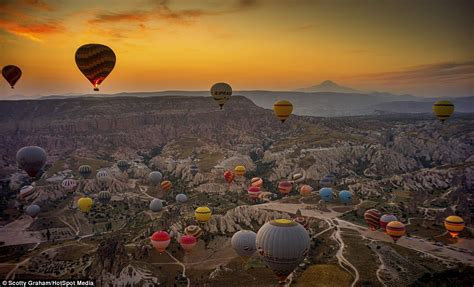 Photographs capture HUNDREDS of hot air balloons floating